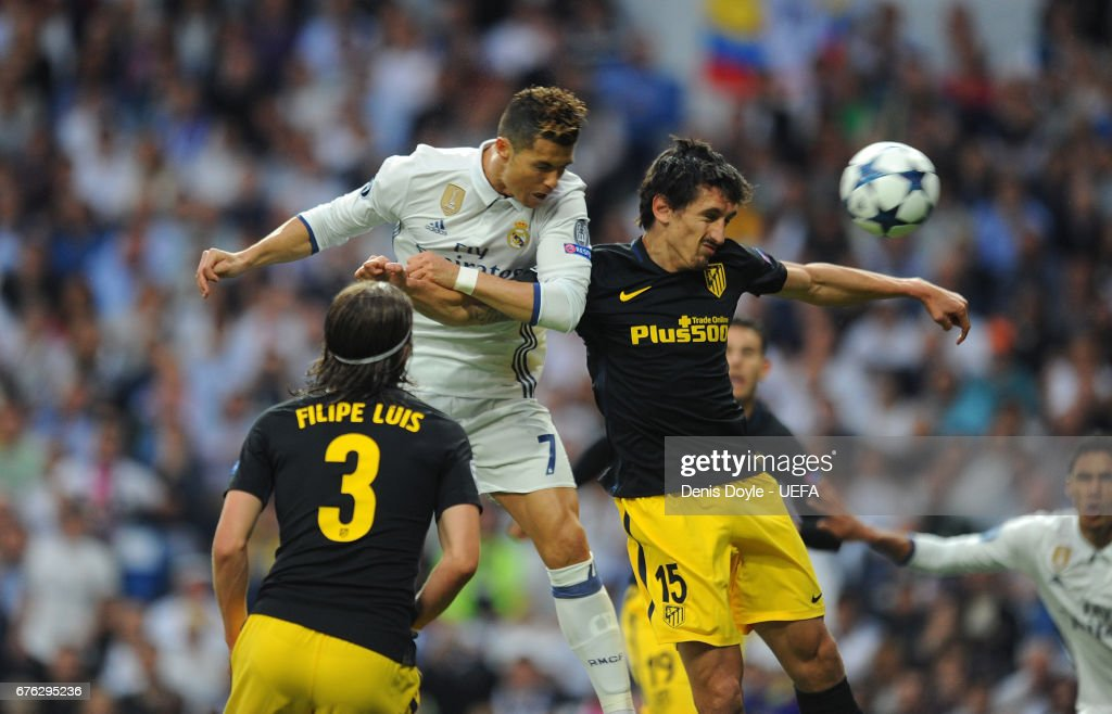 Cristiano Ronaldo of Real Madrid CF beats Stefan Savic of Club Atletico de Madrid to score his team's opening goal in the UEFA Champions League Semi Final first leg match between Real Madrid CF and Club Atletico de Madrid at Estadio Santiago Bernabeu on May 2, 2017 in Madrid, Spain.