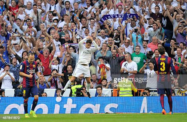 Cristiano Ronaldo of Real Madrid CF celebrates after scoring his team's opening goal from the penalty spot during the La Liga match between Real...