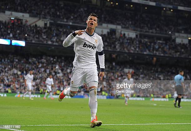 Cristiano Ronaldo of Real Madrid CF celebrates after scoring Real's 2nd goal during the La Liga match between Real Madrid CF and Malaga CF at estadio...