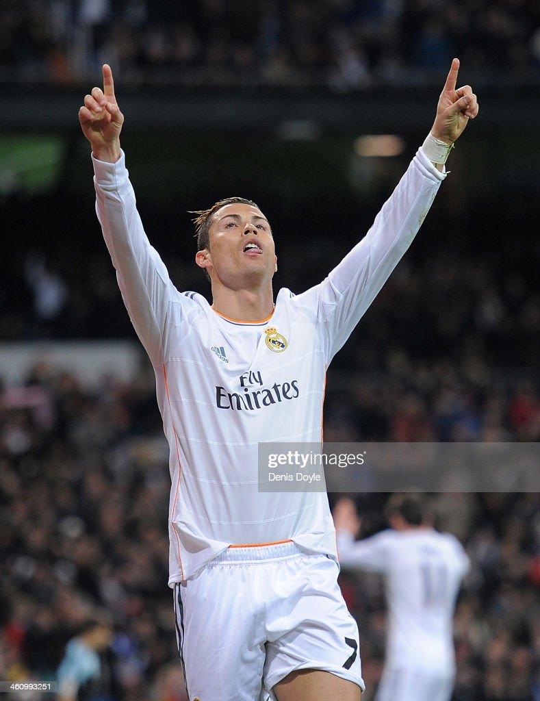 <a gi-track='captionPersonalityLinkClicked' href=/galleries/search?phrase=Cristiano+Ronaldo+-+Soccer+Player&family=editorial&specificpeople=162689 ng-click='$event.stopPropagation()'>Cristiano Ronaldo</a> of Real Madrid CF celebrates after scoring Real's 2nd goal during the La Liga match between Real Madrid CF and RC Celta de Vigo at the Santiago Bernabeu stadium on January 6, 2014 in Madrid, Spain.