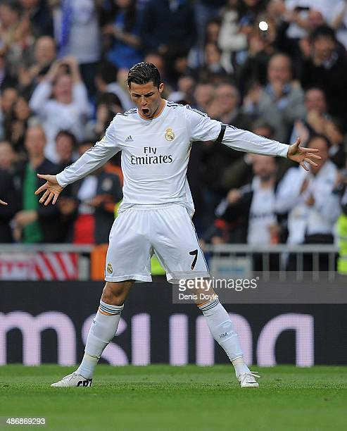 Cristiano Ronaldo of Real Madrid CF celebrates after scoring Real's opening goal from a free kick during the La Liga match between Real Madrid CF and...