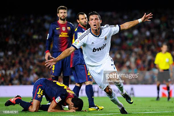 Cristiano Ronaldo of Real Madrid CF celebrates after scoring the opening goal during the Super Cup first leg match between FC Barcelona and Real...