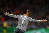 Cristiano Ronaldo of Real Madrid CF celebrates after scoring the opening goal during the UEFA Champions League round of 16 first leg match between AS...