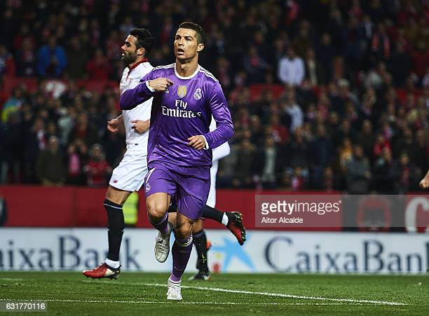 Cristiano Ronaldo of Real Madrid CF celebrates after scoring the first goal for Real Madrid during the La Liga match between Sevilla FC and Real...