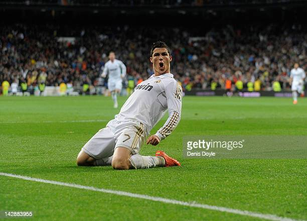 Cristiano Ronaldo of Real Madrid CF celebrates after scoring their second goal during the La Liga match between Real Madrid CF and Real Sporting de...