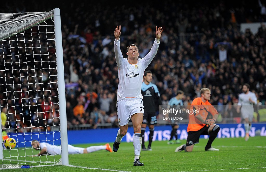 <a gi-track='captionPersonalityLinkClicked' href=/galleries/search?phrase=Cristiano+Ronaldo+-+Soccer+Player&family=editorial&specificpeople=162689 ng-click='$event.stopPropagation()'>Cristiano Ronaldo</a> of Real Madrid CF celebrates after scoring their second goal during the La Liga match between Real Madrid CF and RC Celta de Vigo at the Santiago Bernabeu stadium on January 6, 2014 in Madrid, Spain.