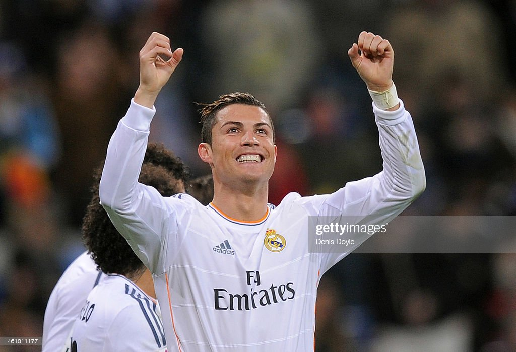 <a gi-track='captionPersonalityLinkClicked' href=/galleries/search?phrase=Cristiano+Ronaldo+-+Soccer+Player&family=editorial&specificpeople=162689 ng-click='$event.stopPropagation()'>Cristiano Ronaldo</a> of Real Madrid CF celebrates after scoring their third goal during the La Liga match between Real Madrid CF and RC Celta de Vigo at the Santiago Bernabeu stadium on January 6, 2014 in Madrid, Spain.