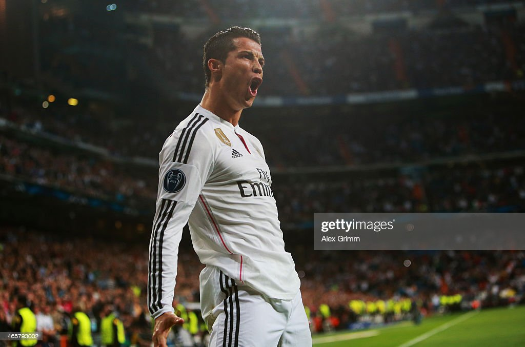 <a gi-track='captionPersonalityLinkClicked' href=/galleries/search?phrase=Cristiano+Ronaldo&family=editorial&specificpeople=162689 ng-click='$event.stopPropagation()'>Cristiano Ronaldo</a> of Real Madrid CF celebrates as he scores their second goal during the UEFA Champions League Round of 16 second leg match between Real Madrid CF and FC Schalke 04 at Estadio Bernabeu on March 10, 2015 in Madrid, Spain.