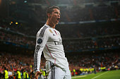 Cristiano Ronaldo of Real Madrid CF celebrates as he scores their second goal during the UEFA Champions League Round of 16 second leg match between...