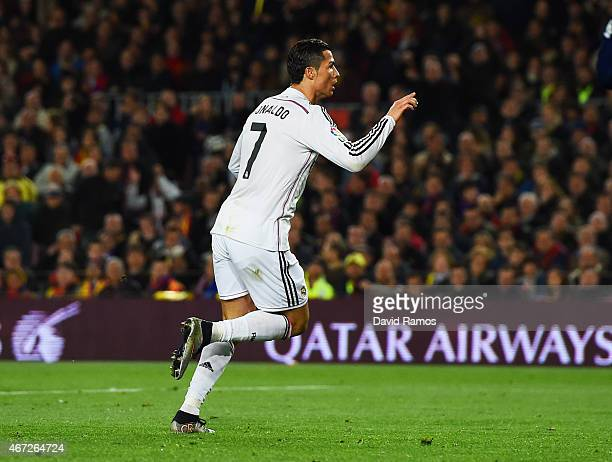 Cristiano Ronaldo of Real Madrid CF celebrates as he scores their first and equalising goal during the La Liga match between FC Barcelona and Real...