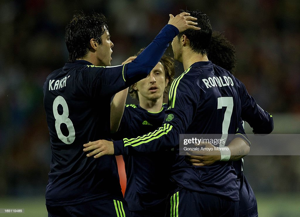 Cristiano Ronaldo (2nd R) of Real Madrid CF celebrates scoring his team's first goal with team-mates Marcelo (R), Luka Modric (2nd L) and Kaka (L) during the La Liga match between Real Zaragoza and Real Madrid CF at La Romareda Stadium on March 30, 2013 in Zaragoza, Spain.