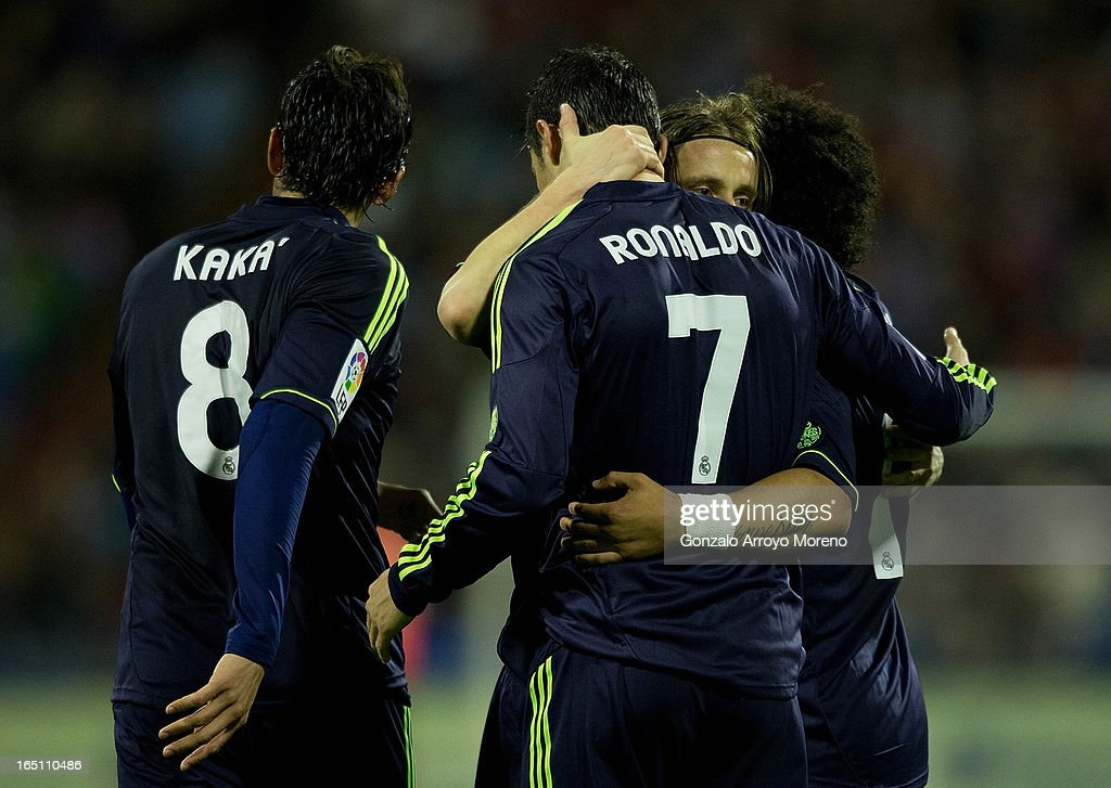 Cristiano Ronaldo (2nd L) of Real Madrid CF celebrates scoring his team's first goal with team-mates Marcelo (R), Luka Modric (2nd R) and Kaka (L) during the La Liga match between Real Zaragoza and Real Madrid CF at La Romareda Stadium on March 30, 2013 in Zaragoza, Spain.