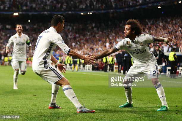 Cristiano Ronaldo of Real Madrid CF celebrates scoring his team's third goal with teammate Marcelo during the UEFA Champions League Quarter Final...