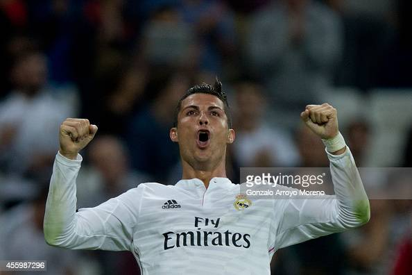 Cristiano Ronaldo of Real Madrid CF celebrates scoring their fifth goal during the La Liga match between Real Madrid CF and Elche CF at Estadio...
