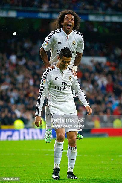 Cristiano Ronaldo of Real Madrid CF celebrates scoring their fifth goal with teammate Marcelo jumpig over him during the La Liga match between Real...