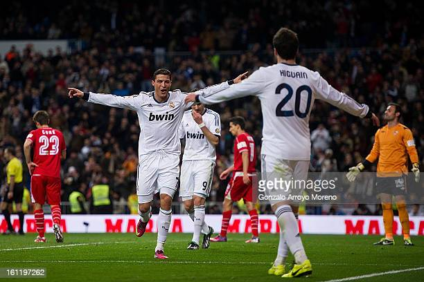 Cristiano Ronaldo of Real Madrid CF celebrates scoring their fourth goal with teammate Gonzalo Higuain during the La Liga match between Real Madrid...