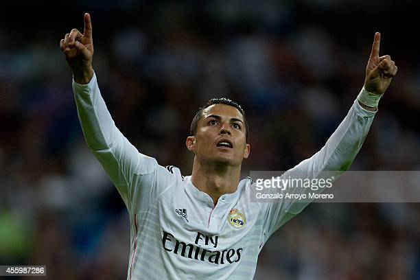 Cristiano Ronaldo of Real Madrid CF celebrates scoring their fourth goal from a penalty shot during the La Liga match between Real Madrid CF and...