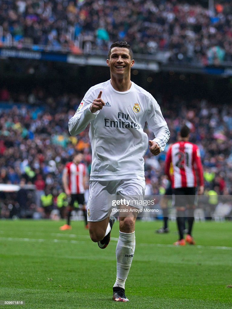 <a gi-track='captionPersonalityLinkClicked' href=/galleries/search?phrase=Cristiano+Ronaldo+-+Soccer+Player&family=editorial&specificpeople=162689 ng-click='$event.stopPropagation()'>Cristiano Ronaldo</a> (R) of Real Madrid CF celebrates scoring their fourth goal during the La Liga match between Real Madrid CF and Athletic Club at Estadio Santiago Bernabeu on February 13, 2016 in Madrid, Spain.