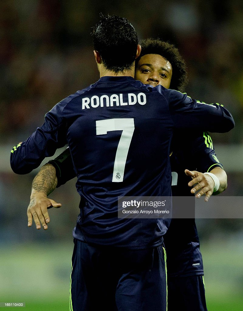 Cristiano Ronaldo (L) of Real Madrid CF celebrates scoring their opening goal with team-mate Marcelo during the La Liga match between Real Zaragoza and Real Madrid CF at La Romareda Stadium on March 30, 2013 in Zaragoza, Spain.