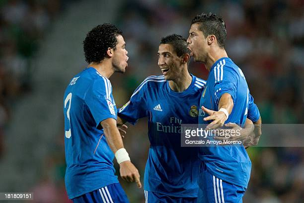 Cristiano Ronaldo of Real Madrid CF celebrates scoring their opening goal with teammates Pepe and Angel Di Maria during the La Liga match between...