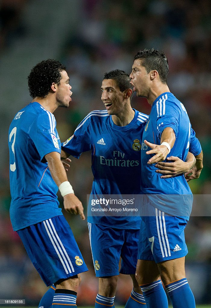 <a gi-track='captionPersonalityLinkClicked' href=/galleries/search?phrase=Cristiano+Ronaldo+-+Soccer+Player&family=editorial&specificpeople=162689 ng-click='$event.stopPropagation()'>Cristiano Ronaldo</a> (R) of Real Madrid CF celebrates scoring their opening goal with teammates Pepe (L) and <a gi-track='captionPersonalityLinkClicked' href=/galleries/search?phrase=Angel+Di+Maria&family=editorial&specificpeople=4110691 ng-click='$event.stopPropagation()'>Angel Di Maria</a> (2ndR) during the La Liga match between Elche FC and Real Madrid CF at Estadio Manuel Martinez Valero on September 25, 2013 in Elche, Spain.