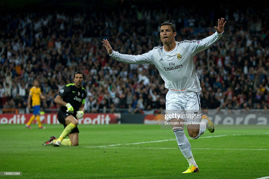 <a gi-track='captionPersonalityLinkClicked' href=/galleries/search?phrase=Cristiano+Ronaldo+-+Soccer+Player&family=editorial&specificpeople=162689 ng-click='$event.stopPropagation()'>Cristiano Ronaldo</a> of Real Madrid CF celebrates scoring their opening goal during the UEFA Champions League Group B match between Real Madrid CF and Juventus at Estadio Santiago Bernabeu on October 23, 2013 in Madrid, Spain.
