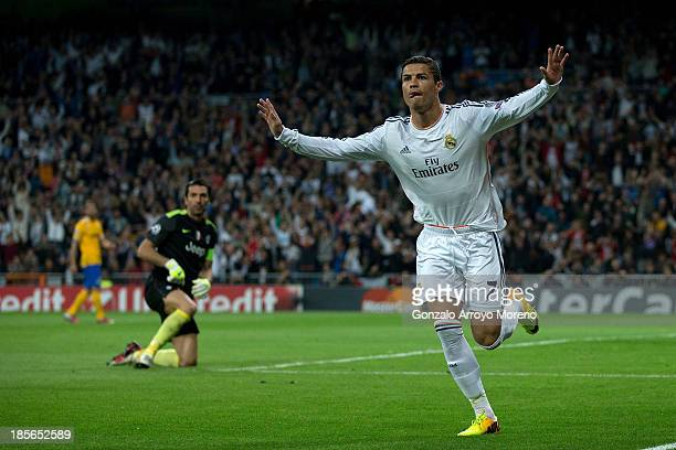 Cristiano Ronaldo of Real Madrid CF celebrates scoring their opening goal during the UEFA Champions League Group B match between Real Madrid CF and...