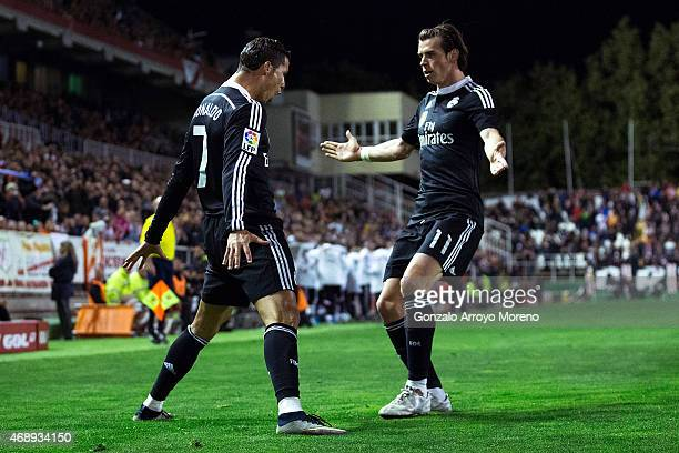 Cristiano Ronaldo of Real Madrid CF celebrates scoring their opening goal with teammate Gareth Bale during the La Liga match between Rayo Vallecano...