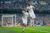 Cristiano Ronaldo of Real Madrid CF celebrates scoring their opening goal with teammate Sergio Ramos during the UEFA Champions League semifinal...