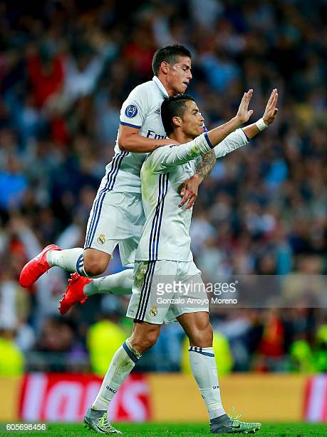 Cristiano Ronaldo of Real Madrid CF celebrates scoring their opening goal with teammate James Rodriguez during the UEFA Champions League group stage...