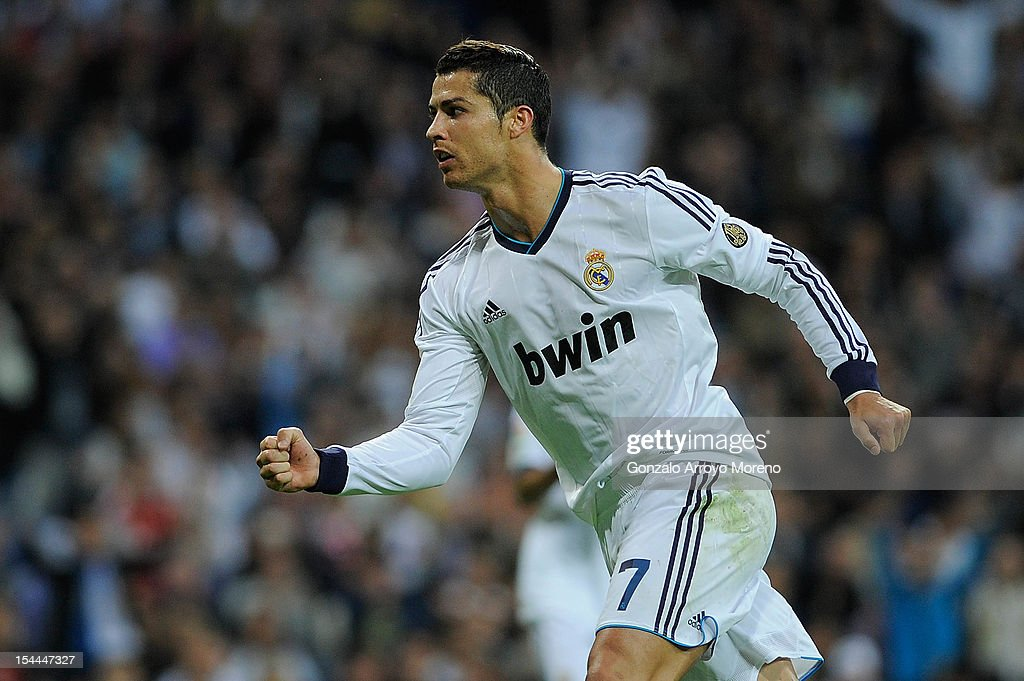 <a gi-track='captionPersonalityLinkClicked' href=/galleries/search?phrase=Cristiano+Ronaldo+-+Soccer+Player&family=editorial&specificpeople=162689 ng-click='$event.stopPropagation()'>Cristiano Ronaldo</a> of Real Madrid CF celebrates scoring their second goal during the La Liga match between Real Madrid CF and RC Deportivo La Coruna at Bernabeu on October 20, 2012 in Madrid, Spain.