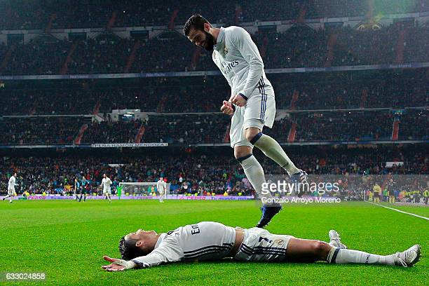 Cristiano Ronaldo of Real Madrid CF celebrates scoring their second goal with teammate Nacho Fernandez during the La Liga match between Real Madrid...