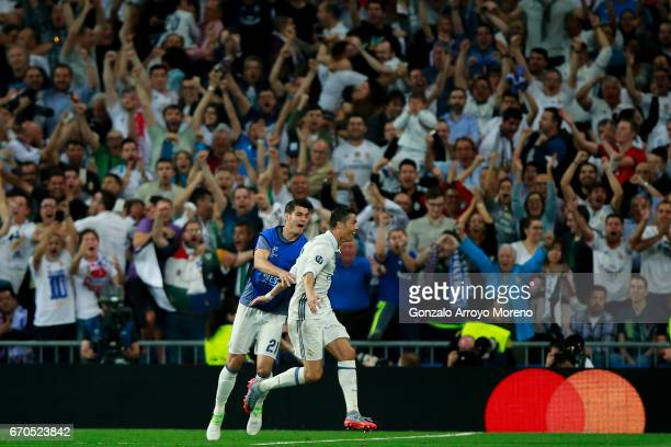 Cristiano Ronaldo of Real Madrid CF celebrates scoring their second goal with teammate Alvaro Morata during the UEFA Champions League Quarter Final...