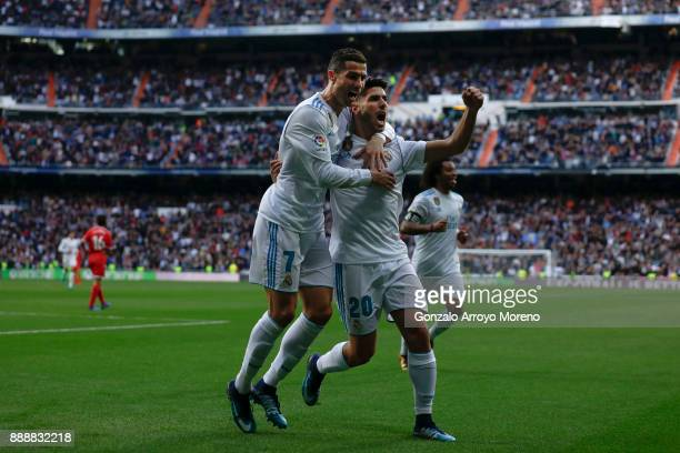 Cristiano Ronaldo of Real Madrid CF celebrates scoring their second goal with teammate Marco Asensio during the La Liga match between Real Madrid CF...