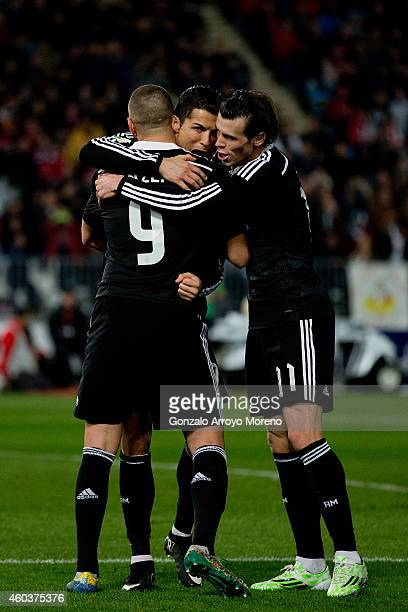 Cristiano Ronaldo of Real Madrid CF celebrates scoring their third goal with teammate Karim Benzema and Gareth Bale during the La Liga match between...