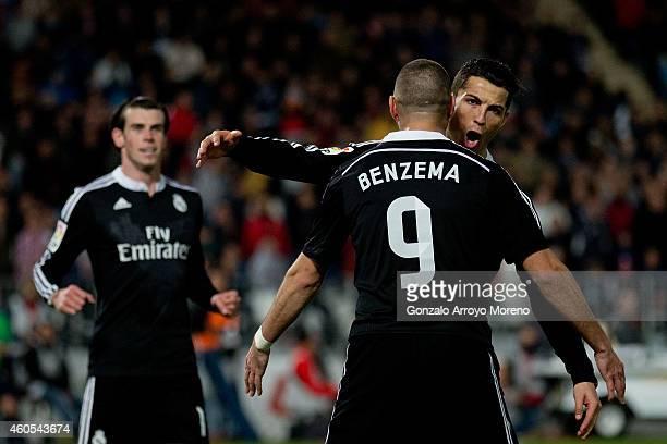 Cristiano Ronaldo of Real Madrid CF celebrates scoring their third goal with teammate Karim Benzema as Gareth Bale runs to them during the La Liga...