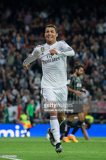 Cristiano Ronaldo of Real Madrid CF celebrates scoring their third goal during the La Liga match between Real Madrid CF and Malaga CF at Estadio...