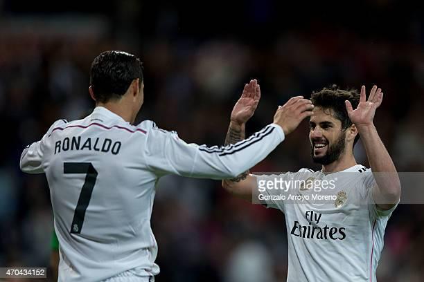 Cristiano Ronaldo of Real Madrid CF celebrates scoring their third goal with teammate Francisco Roman Alarcon alias Isco during the La Liga match...