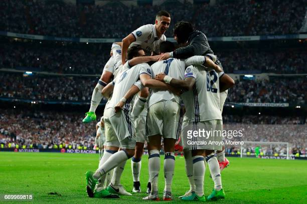 Cristiano Ronaldo of Real Madrid CF celebrates scoring their third goal with teammates during the UEFA Champions League Quarter Final second leg...
