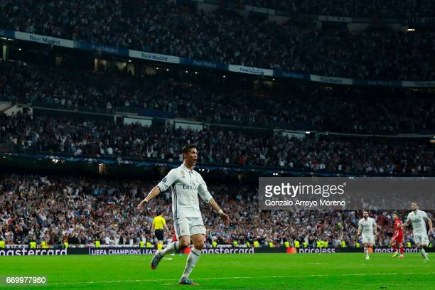 Cristiano Ronaldo of Real Madrid CF celebrates scoring their third goal during the UEFA Champions League Quarter Final second leg match between Real...