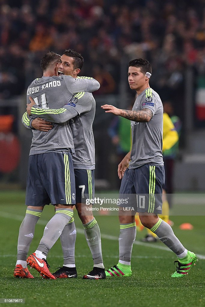 Cristiano Ronaldo (C) of Real Madrid CF celebrates the opening goal with team mate Sergio Ramos (L) during the UEFA Champions League Round of 16 First Leg match between AS Roma and Real Madrid CF at Stadio Olimpico on February 17, 2016 in Rome, Italy.