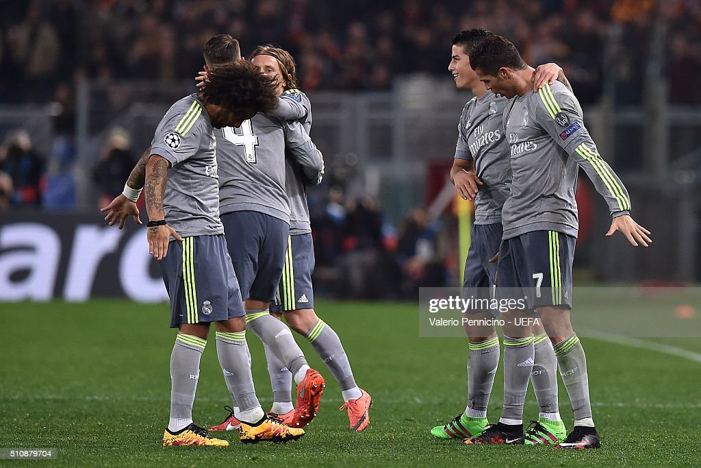 Cristiano Ronaldo (R) of Real Madrid CF celebrates the opening goal with team mates during the UEFA Champions League Round of 16 First Leg match between AS Roma and Real Madrid CF at Stadio Olimpico on February 17, 2016 in Rome, Italy.