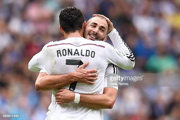 Cristiano Ronaldo of Real Madrid CF celebrates with his teammate Karim Benzema of Real Madrid CF after scoring his team's third goalduring the La...