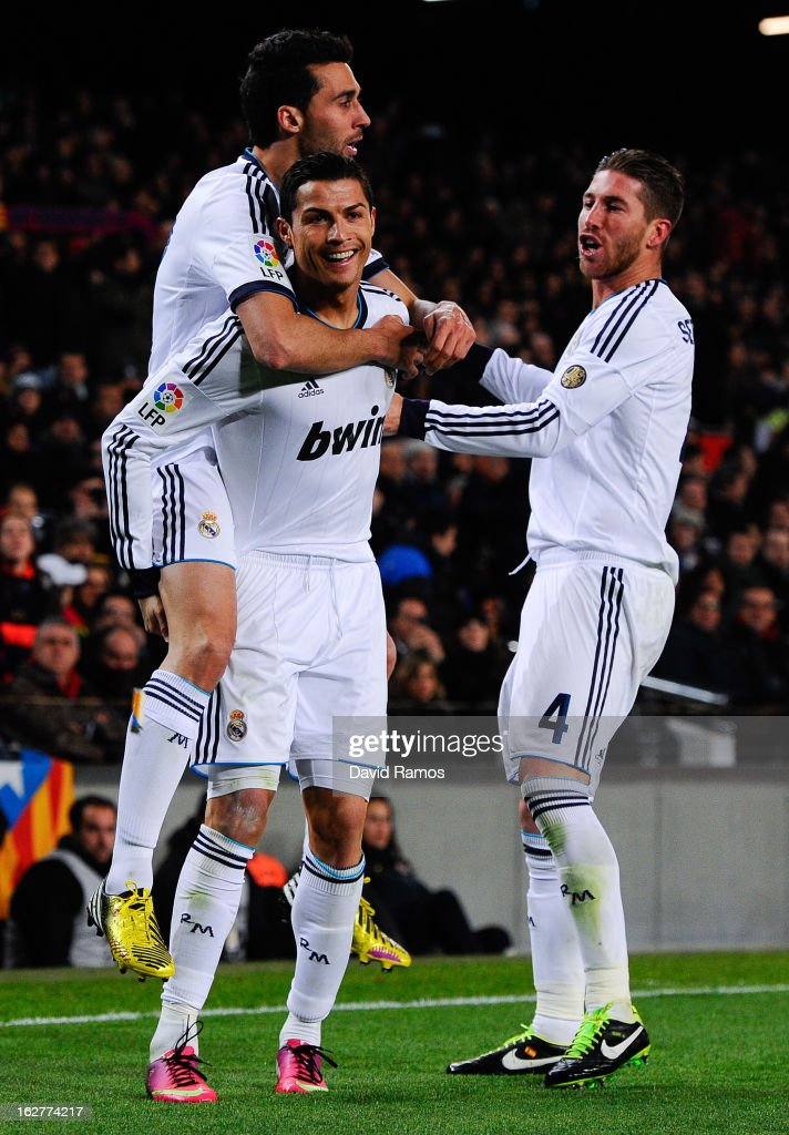 Cristiano Ronaldo (C) of Real Madrid CF celebrates with his team-mates Alvaro Arbeloa (L) and Sergio Ramos after scoring their second goal during the Copa del Rey Semi Final second leg between FC Barcelona and Real Madrid at Camp Nou on February 26, 2013 in Barcelona, Spain.