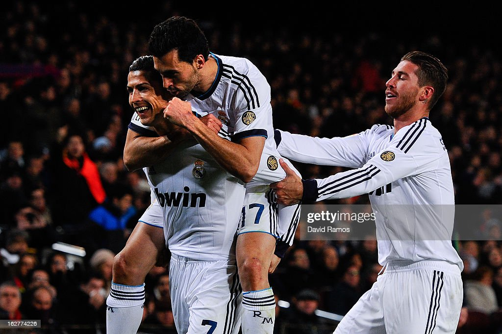 Cristiano Ronaldo (L) of Real Madrid CF celebrates with his team-mates Alvaro Arbeloa (C) and Sergio Ramos after scoring his team's their goal during the Copa del Rey Semi Final second leg between FC Barcelona and Real Madrid at Camp Nou on February 26, 2013 in Barcelona, Spain.