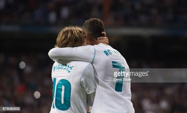 Cristiano Ronaldo of Real Madrid CF celebrates with Luka Modric after scoring his team's 3rd goal from a penalty rebound during the La Liga match...
