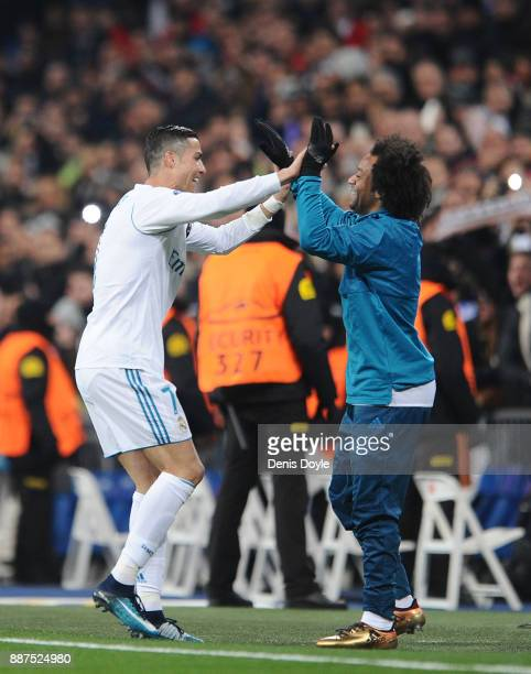 Cristiano Ronaldo of Real Madrid CF celebrates with Marcelo after scoring Real's 2nd goal during the UEFA Champions League group H match between Real...