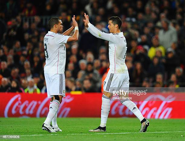 Cristiano Ronaldo of Real Madrid CF celebrates with Pepe as he scores their first and equalising goal during the La Liga match between FC Barcelona...