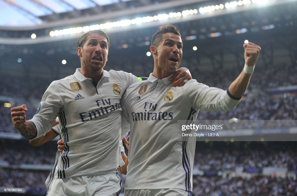 Cristiano Ronaldo of Real Madrid CF celebrates with Sergio Ramos after scoring his team's opening goal in the UEFA Champions League Semi Final first leg match between Real Madrid CF and Club Atletico de Madrid at Estadio Santiago Bernabeu on May 2, 2017 in Madrid, Spain.