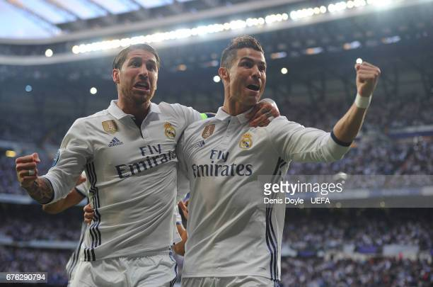 Cristiano Ronaldo of Real Madrid CF celebrates with Sergio Ramos after scoring his team's opening goal in the UEFA Champions League Semi Final first...